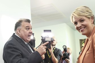 Craig Kelly and Tanya Plibersek argue in the hallway of Parliament House on Wednesday.
