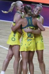Australia's players congratulate each other after winning their Netball World Cup semifinal.