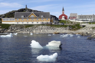 Small pieces of ice float off the shore in Nuuk, Greenland, last month, as the heatwave in Europe prompted fears, now realised, of a massive ice melting event.