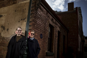 Sarah Hayes, left, and Barbara Minchinton outside Little Lon Gin, one of the few remaining vestiges of the former red light district of Little Lon.