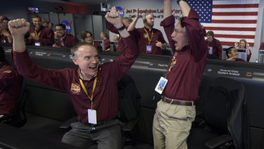Mars InSight team members Kris Bruvold and Sandy Krasner rejoice inside the Mission Support Area at NASA's Jet Propulsion Laboratory in California after receiving confirmation that the Mars InSight lander had successfully touched down.