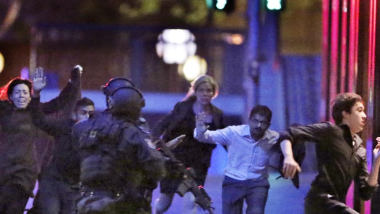 Hostages run from the Lindt Cafe towards Special Operations police on December 16, 2014.