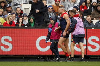 Steven May leaves the field during Sunday's clash with Geelong.