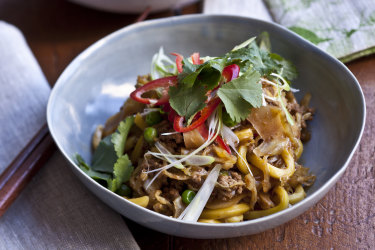 Karen Martini's chow mien style pork  with cabbage, peas and hokkien noodles.