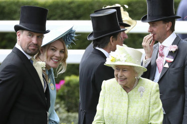 The Queen with her grandson, Peter Phillips, left, and his wife Autumn in June last year.
