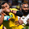 Fiji's Semi Radradra wraps up the Wallabies' Fijian-born centre Samu Kerevi on Saturday.