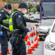 Police controlling access to virus-hit suburbs may become routine.