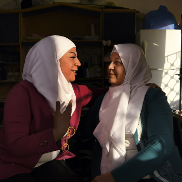 Lara Shaheen, 36, (left) talks with her mother, Hasna'a al-Beesh, 56, in the sewing room at Jasmine Foundation in Irbid, Jordan.
