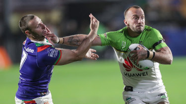 Milestone man: Raiders captain Josh Hodgson fends offs Warriors half Blake Green.