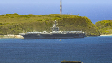 The USS Theodore Roosevelt, a Nimitz-class nuclear powered aircraft carrier, is docked along Kilo Wharf of Naval Base Guam.