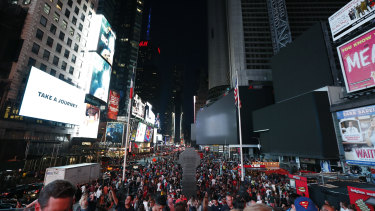 Some screens in Times Square are black during the power outage.