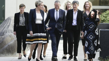 Labor leader Bill Shorten surrounded by female members of his frontbench on Tuesday.