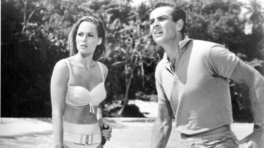 Connery with Ursula Andress in a scene from Dr No (1962).
