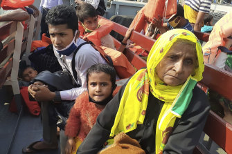 Rohingya refugees board a ship as they are ferried to Bhashan Char.