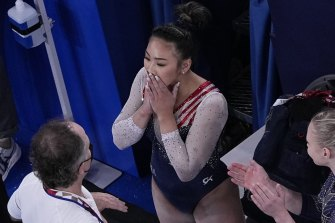 Lee reacts after getting her score for the floor apparatus