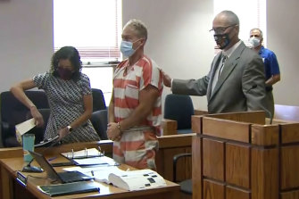 In this still image from video, Barry Morphew, centre, appears in court in Salida, Colorado earlier this month in connection with the disappearance of his wife, Suzanne.