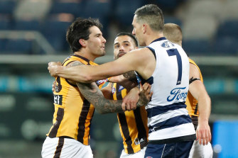 Chad Wingard and Harry Taylor of the Cats clash.