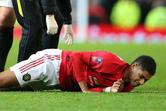 Marcus Rashford lies on the ground injured during the Wolves match.
