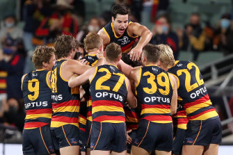 Retiring Crow David Mackay is mobbed by teammates after kicking a late goal.