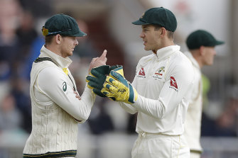 Steve Smith, left, speaks with Tim Paine, right, at the fourth Test against England in September.