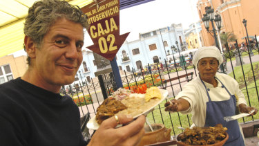 Anthony Bourdain in the Plaza Italia in the Peruvian capital, Lima, filming his series <i>No Reservations</i>.