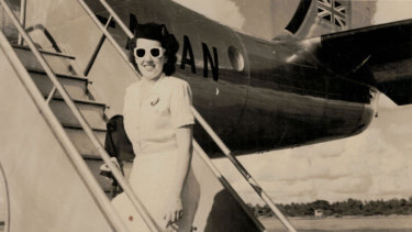 Up and away: freshly minted Qantas hostess Patricia Burke arrives for work in summer uniform, 1948.