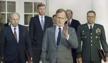 President George H.W. Bush talks to reporters in the Rose Garden of the White House in 1991. He is surrounded by then (from left) defence secretary Dick Cheney, vice-president Dan Quayle, White House chief of staff John Sununu, secretary of sState James Baker, and joint chiefs chairman General Colin Powell.