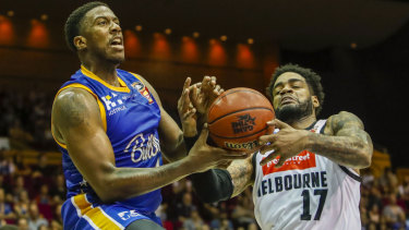 Lamar Patterson (left) of the Bullets drives to the basket during the round 8 NBL match against Melbourne United at the Brisbane Convention and Exhibition Centre on Saturday.