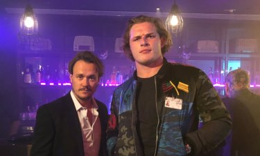 Getting in on the act: George Burgess (right) on the set of the Australian action movie Locusts with star Ben Geurens.