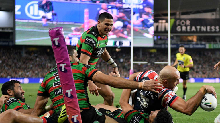 Hunger games: Blake Ferguson reaches out to plunge a dagger into Rabbitohs' hearts.