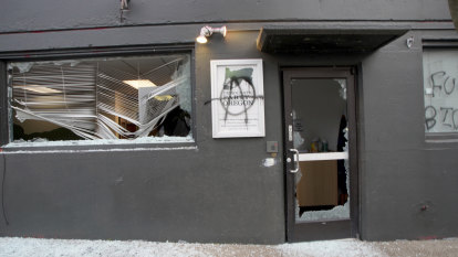 Anti-fascist protesters vandalise buildings in Portland and Seattle over Biden inauguration