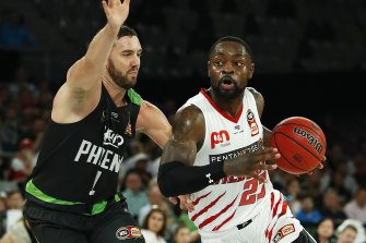 Fast break: Terrico White drives forward for Perth against South East Melbourne at Melbourne Arena.