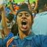 Indian fans celebrate as a Pakistan wicket falls in a 2015 Cricket World Cup match at the Adelaide Oval.