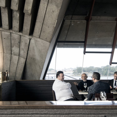 Fink Group owner Leon Fink (second from left) tastes Quay's new menu with a group including its executive chef Peter Gilmore (left) at sister venue, the Opera House's Bennelong.