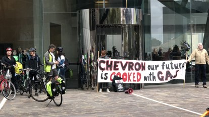 Grandparents superglue themselves to Chevron HQ in Perth protest