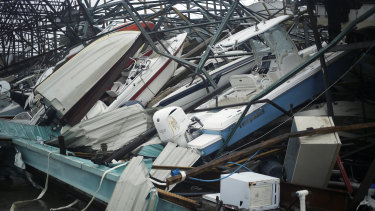 Boats sit in a storage warehouse damaged by Hurricane Michael in Panama City Beach, Florida.