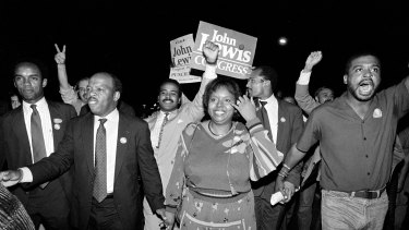 John Lewis, front left, and his wife, Lillian, holding hands, lead a march of supporters in 1986.