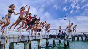Beachgoers seek a break from hot weather at Port Melbourne.