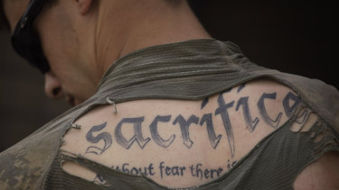 A tattoo on the back of US Army Sergeant James Wilkes seen through his torn shirt in Afghanistan's Kandahar province in 2010.