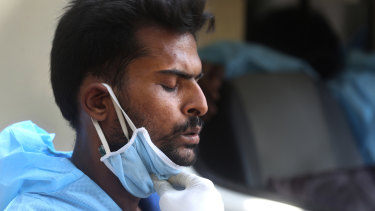 The strain of the pandemic is felt everywhere: An ambulance driver in Mumbai, India, takes a deep breath as he waits for hours outside a hospital to admit a COVID-19 patient.