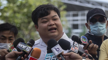 "Activist Parit ""Penguin"" Chiwarak talks to reporters before one of his court appearances in Bangkok."