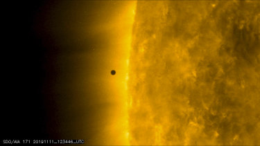 This still image from video issued by NASA's Solar Dynamics Observatory shows Mercury as it passes between Earth and the sun on Monday, November 11.