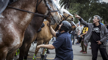 "Police horses outside the NGV during the ""Freedom Day"" protest."