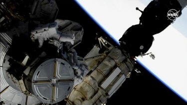 Astronauts Anne McClain and Nick Hague taking a spacewalk to replace ageing batteries on the International Space Station.