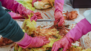 People prepare the traditional food at a kimchi-making festival in Goesan, South Korea.