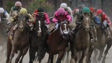 Jockey Luis Saez on Maximum Security (second from right) in the Kentucky Derby. Legal action is being taken over the horse's disqualification.