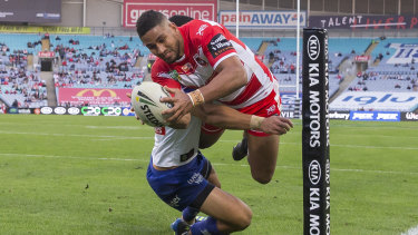 Nene McDonald scores for the Dragons against the Bulldogs at ANZ Stadium on Monday. 21,376 people turned up.