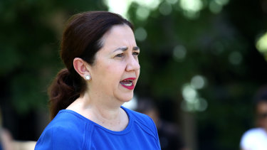 Premier Annastacia Palaszczuk speaks to the media at the University of Queensland on Sunday.