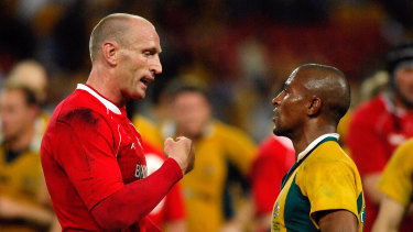 Solidarity: Gareth Thomas alongside former Wallabies captain George Gregan back in his playing days.