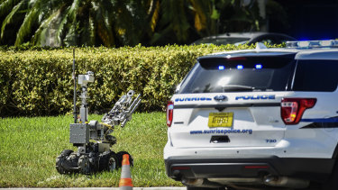 A bomb defusing robot is sent into the Florida building that houses Congresswoman Deborah Wasserman Schultz's office.